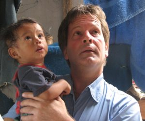 Patrick Atkinson and small boy in Guatemala both reacting to hearing a volcanic blast